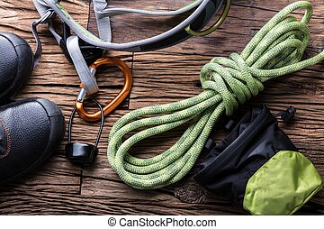 Elevated View Of Hiking Equipment On Wooden Background