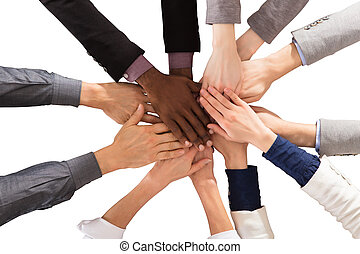 Multi Ethnic Business People Stacking Hands - Elevated View...