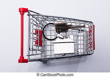 Elevated View Of Shopping Cart And House Key