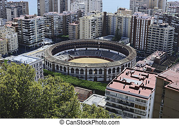 Elevated view of the bullring and Malaga city, Malaga Province, Andalusia, Spain, Western Europe