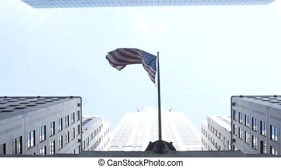 Elevated view of the skyscrapers and national american flag...