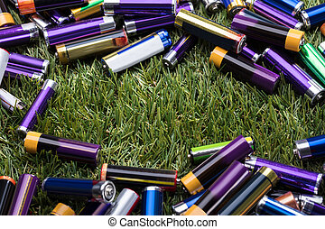 Elevated View Of Used Batteries On Green Grass