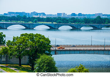 elevated view of Washington DC by the Potomac river. In the picture is Theodore Roosevelt memorial bridge.