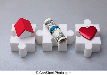 Elevated View Of White Jigsaw Puzzle With House Model