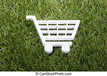 Elevated View Of White Shopping Cart On Green Grass