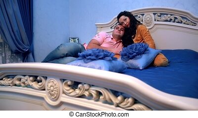 Elevated view of a happy couple embracing in bed ,romantic atmosphere