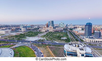 Elevated view over the city center and central business district day to night Timelapse, Central Asia, Kazakhstan, Astana