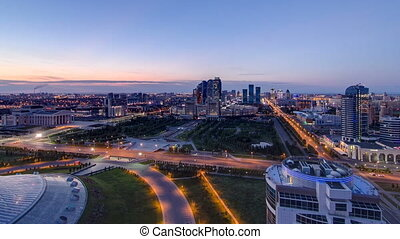 Elevated view over the city center and central business district night to day Timelapse, Kazakhstan, Astana