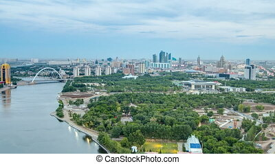 Elevated view over the city center with river and park and central business district day to night Timelapse, Central Asia, Kazakhstan, Astana