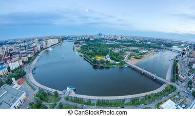 Elevated view over the city center with river and park and...
