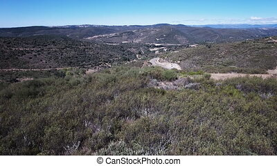 Elevating camera over curved mountain road - Curved mountain...