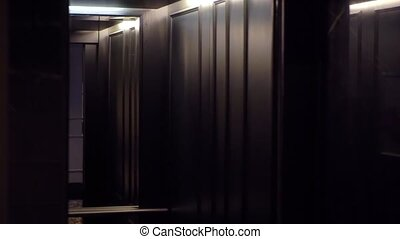 Elevator arriving and opening doors