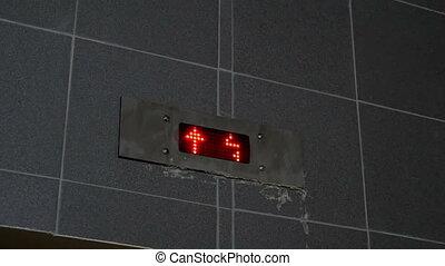 Elevator. Digital display - one, two, three floors close up