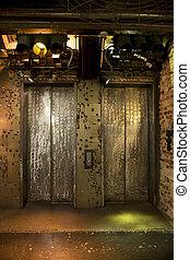 Elevator doors - Elevators lit with grunge effect