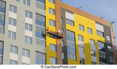 Elevator going down on building at building site