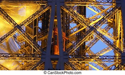 Elevator moving up to the top of the Eiffel tower in Paris,...