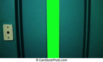 Elevator open with green screen