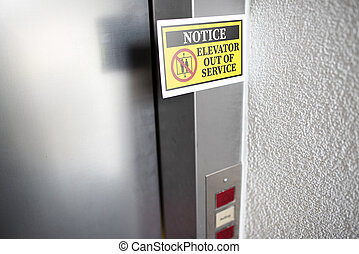 elevator out of service sign attached to elevator door