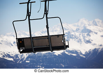 elevator ski mountains on background