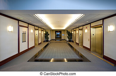 Elevators in brass and mahogany located in modern office building