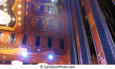 Elevators operate inside beautiful cruise liner, side view,...