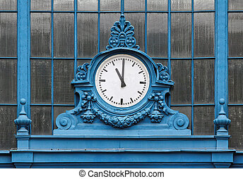 eleven - Eleven hours show the train station clock.