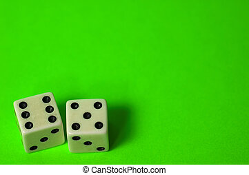 Eleven - Photo of Dice on a Green Background. Part of Series