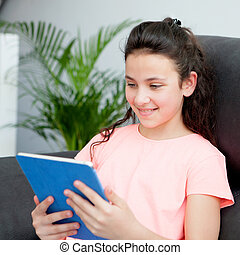Eleven year old girl playing with a tablet