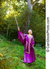 Elf girl with a sword in forest