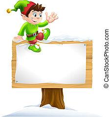 Elf on Snowy Sign - A cute Christmas elf on sitting on a...