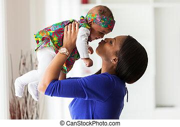 elle, africaine, jeune, américain, mère, dorlotez fille, jouer