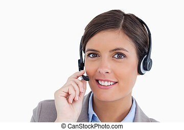 elle, fin, fond, centre, ajustement, casque à écouteurs, femme, agent, contre, sourire, appeler, blanc, haut