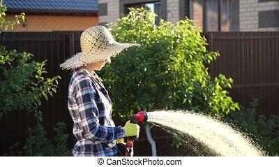 elle, passe-temps, usines, concept, jardin, jeune, arrosage, femme, hose.