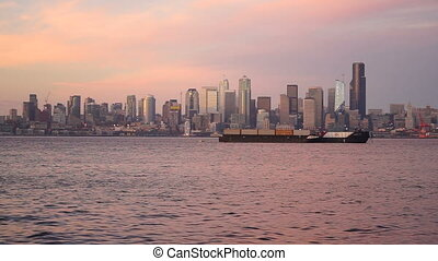 Static panoramic shot of Seattle and the waterfront at sunset