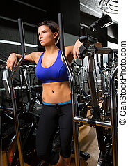 elliptical walker trainer womman posing relaxed at gym