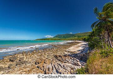Ellis Beach with rocks near Palm Cove, Queensland, Australia