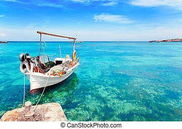 Els Pujols beach in Formentera with traditional fishing boat...