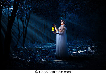 Elven girl with lantern in night forest
