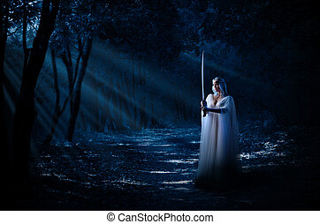 Elven girl with sword in night forest