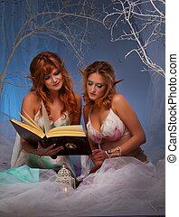 Elves in magical forest with a book.