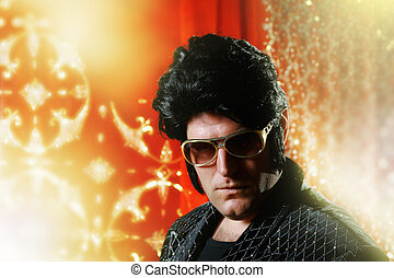 Elvis Presley impersonator over glowing background.