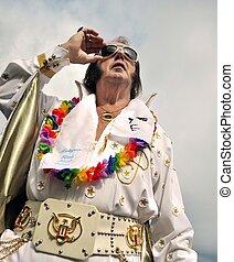 Elvis Presley impersonator looking in a sky