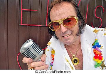 Elvis Presley impersonator with a vintage microphone