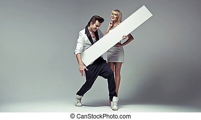 Elvis' style man with his delicate girlfriend