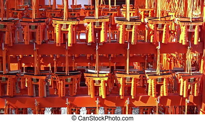 Ema prayer tables with unique Torii gates boards at Fushimi Inari Taisha Temple, Kyoto.