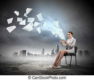 Email concept - Image of businesswoman sitting on chair with...