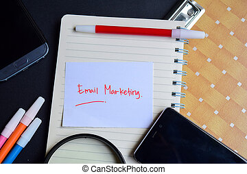 email marketing written on paper isolated on black table