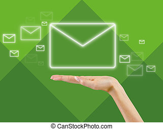 email symbol in the palm of hand