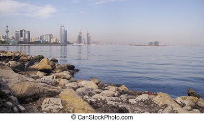 Embankment of Baku, Azerbaijan. The Caspian Sea, Stones and Skyscrapers