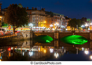Embankment of Liffey River in Dublin, Ireland. Night view with buildings and city lights at the background